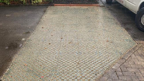 Parking spaces created in a soiled area using plastic grids infilled with permeable stone. They are a lightweight and strong reinforcement system ideal for carparks, driveways, and pathways. They are also 90% porous helping prevent potholes from forming